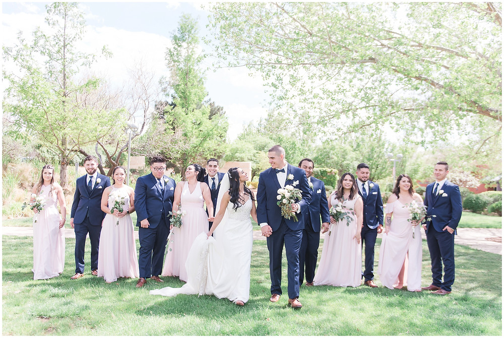 Navy blue and pink color scheme wedding. Pink bridesmaids and navy blue groomsmen in outdoor wedding
