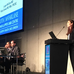 Dr. Logan McGinn presented her research at the podium of the International Federation of Societies for Surgery of the Hand in Berlin, Germany in June 2019.