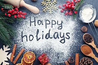 Inscription Happy Holidays on wheat flou
