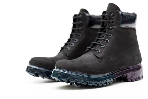 """Timberland 6"""" premium boots in jet black customized with a rubber drip sole that fades from a deep teal to a midnight purple towards the heel. The collar was also dripped with a marbleized deep teal and midnight purple with raised rubber stalactites atop."""