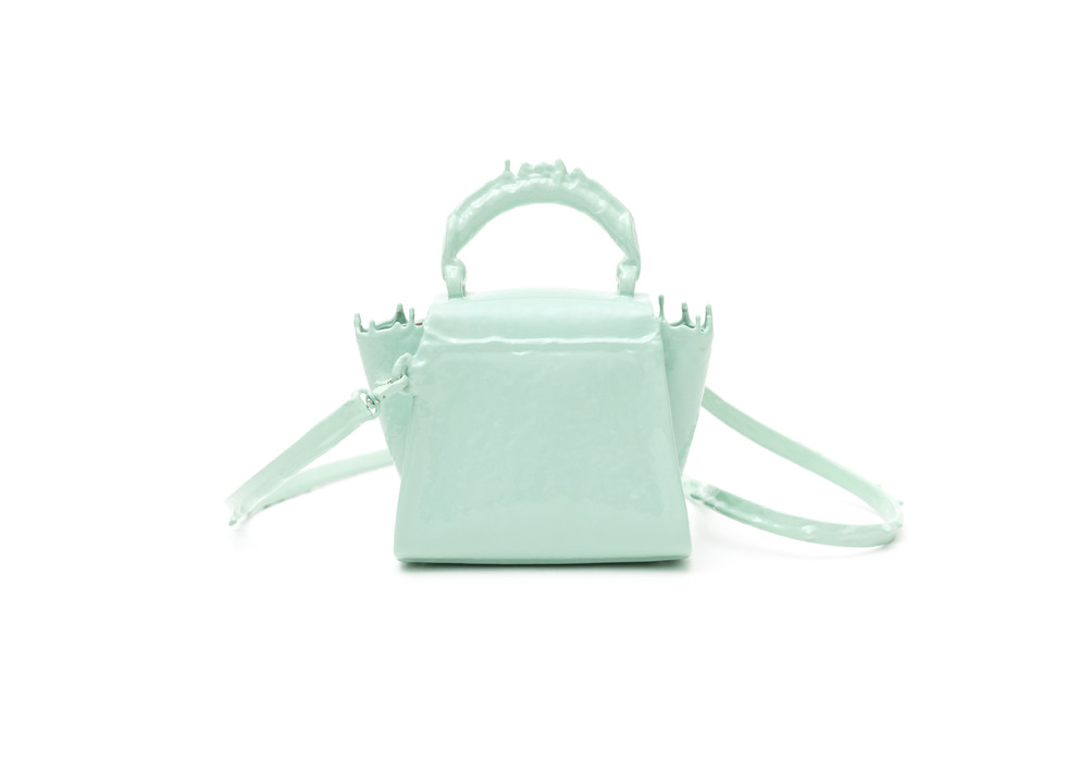 A Zac Zac Posen Mini Satchel handbag in rubber covered drip look. The rubber material is individually mixed for each coating.