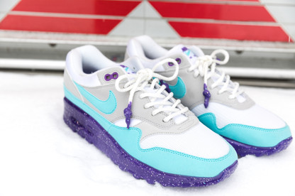 """A pair of @nike Air Max 1 Anniversary """"Aquas"""" featuring a glittered rubber drip sole that is faded from lighter to dark purple through the heel. To complete, a pair of Dyneema rope laces were dripped in the glittered rubber as well."""