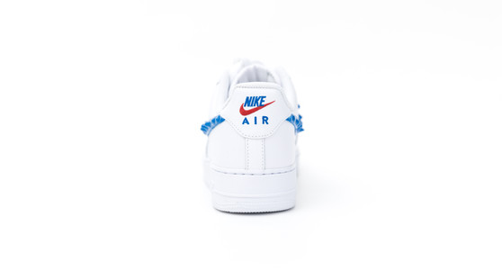 Nike AF1's with a rubber drip pattern applied by hand to the swoosh in Red and Blue. Rubber accents were applied to the lace tips, the lace locks, and a custom dripped shoebox. To finalize the shoe the stitched logos on the heel were handpainted in red and blues. Rubber Drip Nikes