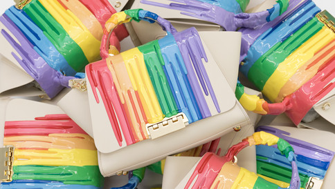 The Rainbow Rubber Drip handbag collection, in collaboration with Zac Posen Zac Zac Posen. A rubber drip pattern is applied to the satchel and is manipulated by hand. A portion of the proceeds goes to Elizabeth Taylor AIDS Foundation.