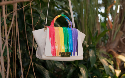 A Rainbow rubber drip pattern is applied to the satchel and is manipulated by hand. Each shade of color is individually mixed, poured, and cured before the next color can be applied. A portion of the proceeds from this bag goes to support the Elizabeth Taylor AIDS Foundation.
