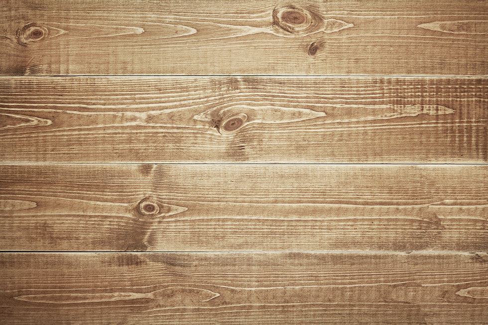 Background image for Yelp Review Seciton. An image of light wood planks spanning left to right in the background.