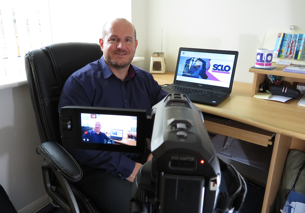 Steve O'Hare sits at his desk in front of a camera.