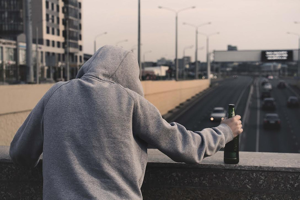 Depressed guy with a beer