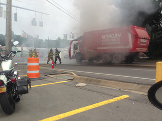 GARBAGE TRUCK FIRE ON WEST GENESEE STREET