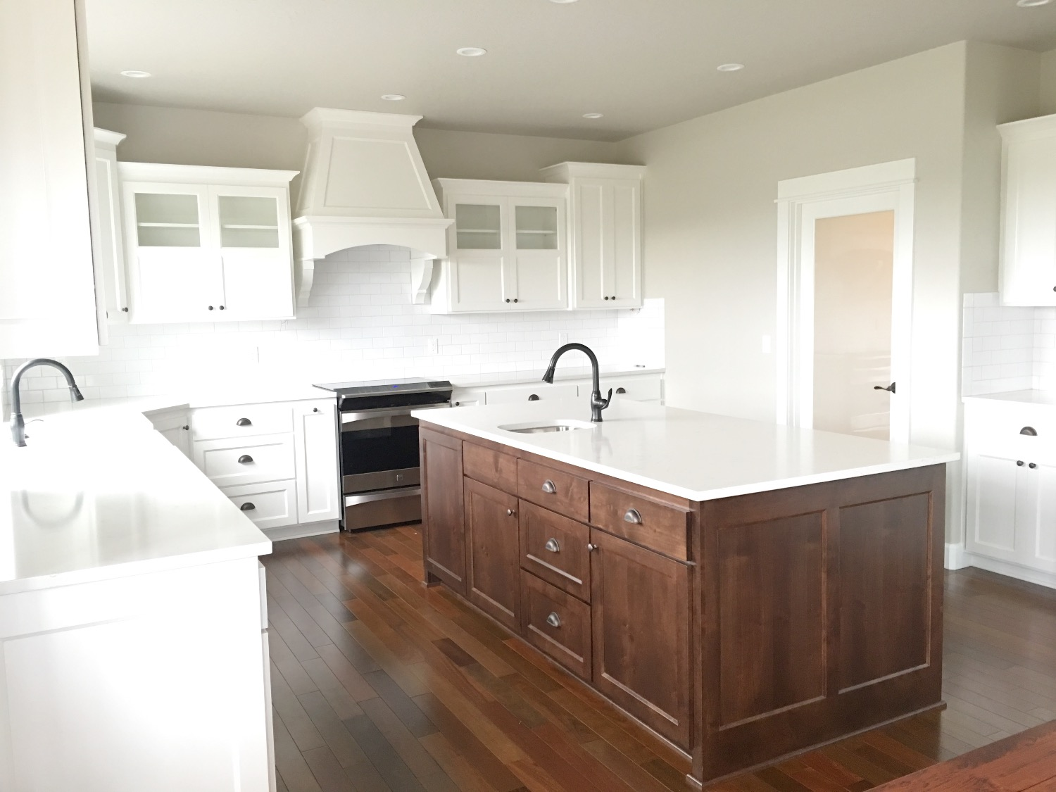 Nordic Homes White Kitchen with Stained Island
