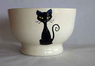 A bowl decorated with three cats. Click to see a variety of works involving animals.