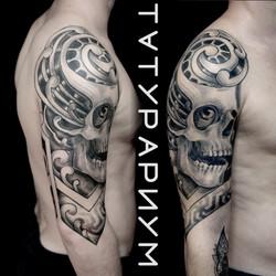 Фото татуировки, череп с узором на плече