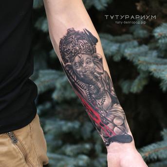 Фото татуировки, ганеша в стиле реализм