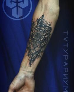 Фото татуировки, тирг с узорами на предп