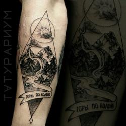 Фото татуировки, горный пейзаж в ромбе н
