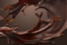 splash of brownish hot coffee or chocola