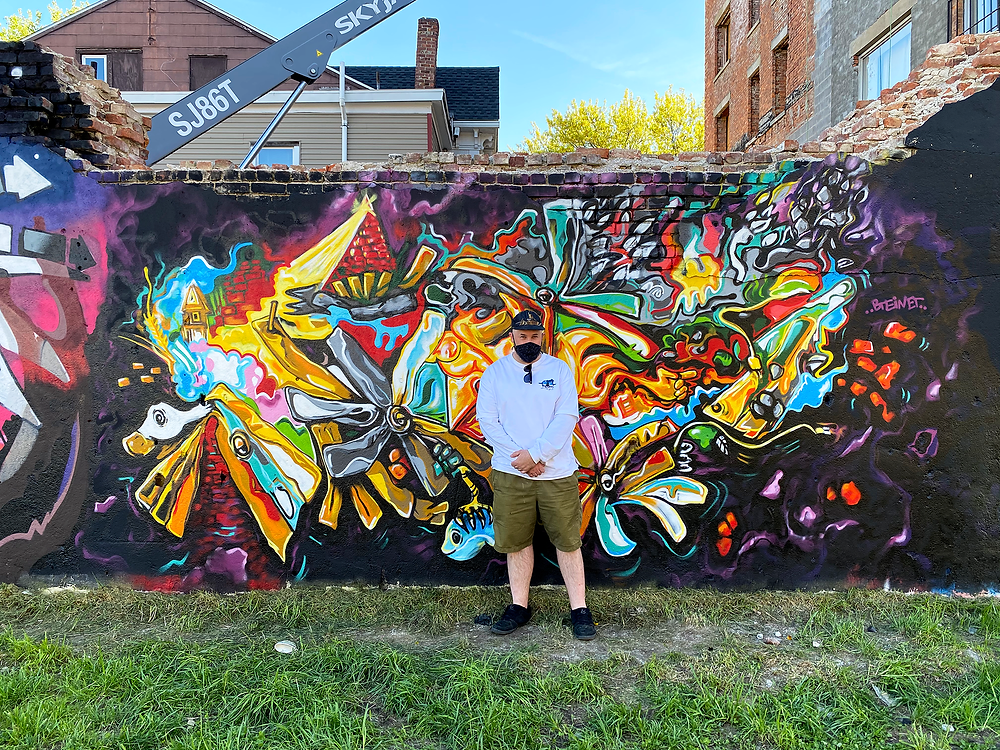 """Me posing in front of my mural """"FLEW"""" - May 2021"""