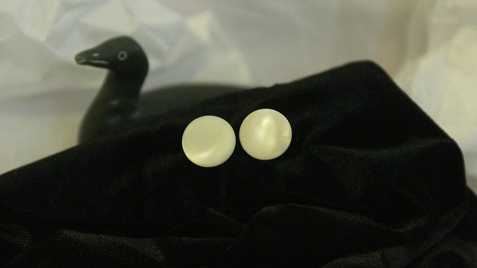 Faux mother of pearl studs.