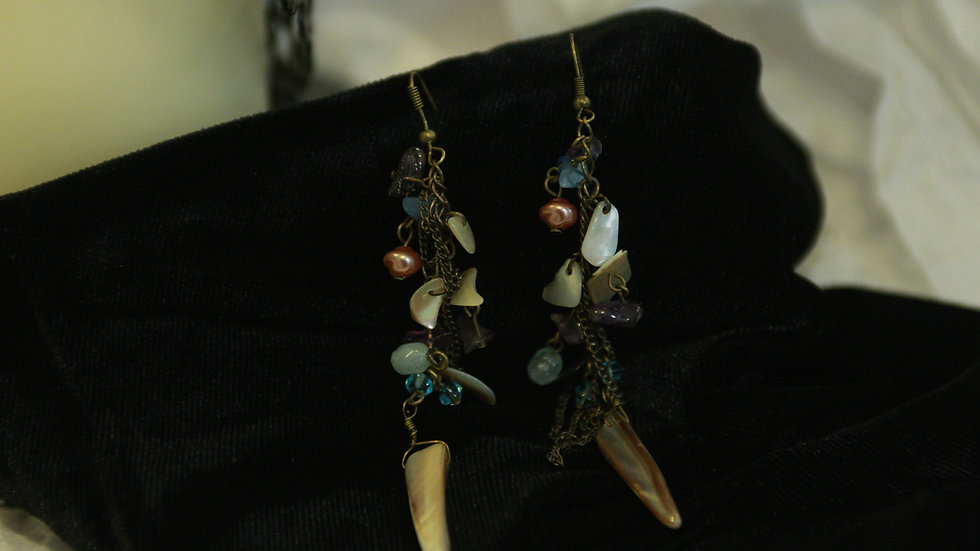 Long cream beads with shell spike