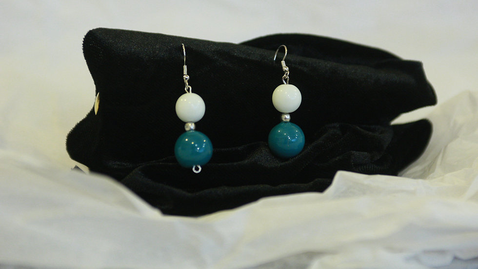 Whit and teal drops