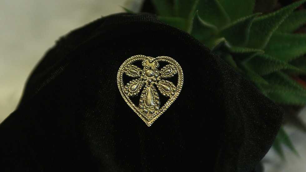 Heart shaped pin.