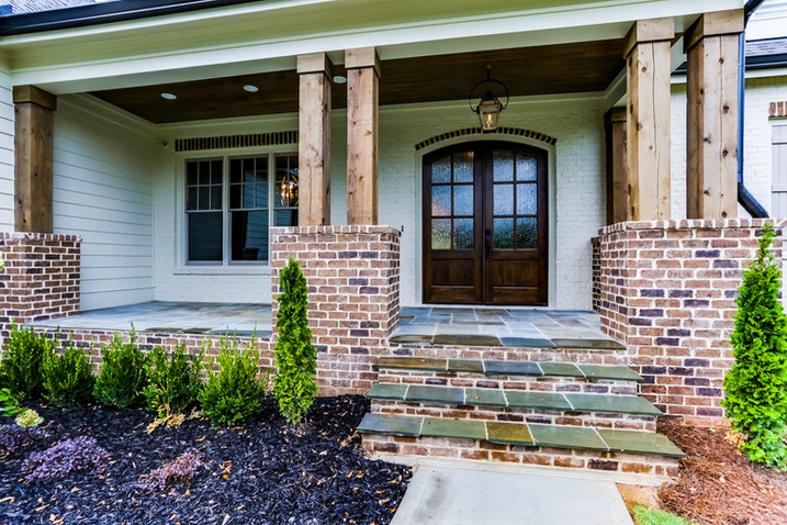 Custom Hardscaping and Dignified Brick Work Additions to Your Front Porch and Walkway
