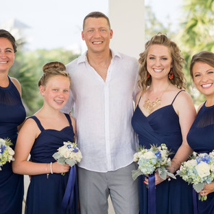 groom with bridesmaids outdoor natural light photo