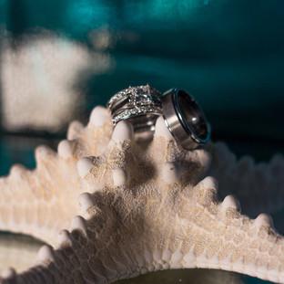 rings on starfish beach style wedding photography