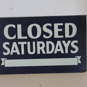 Closed Saturdays sign