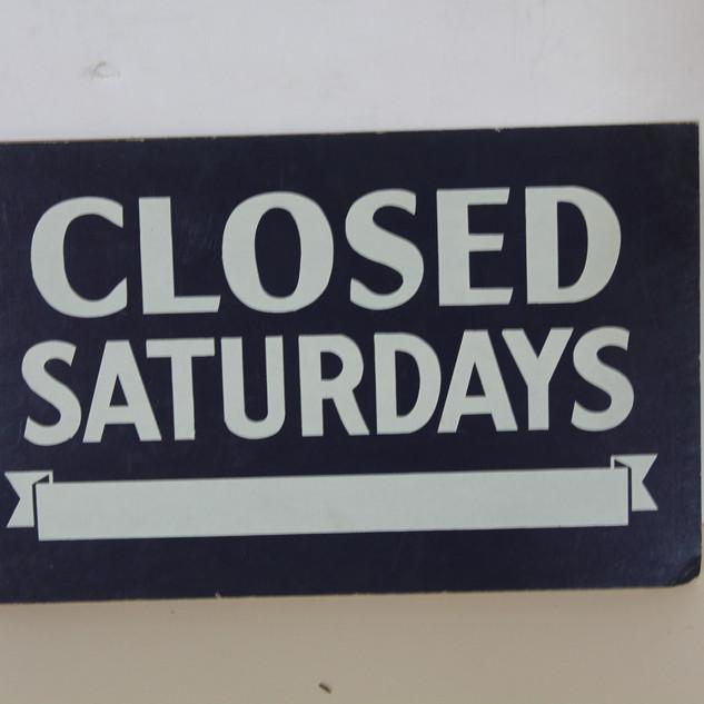 Closed Saturdays sign
