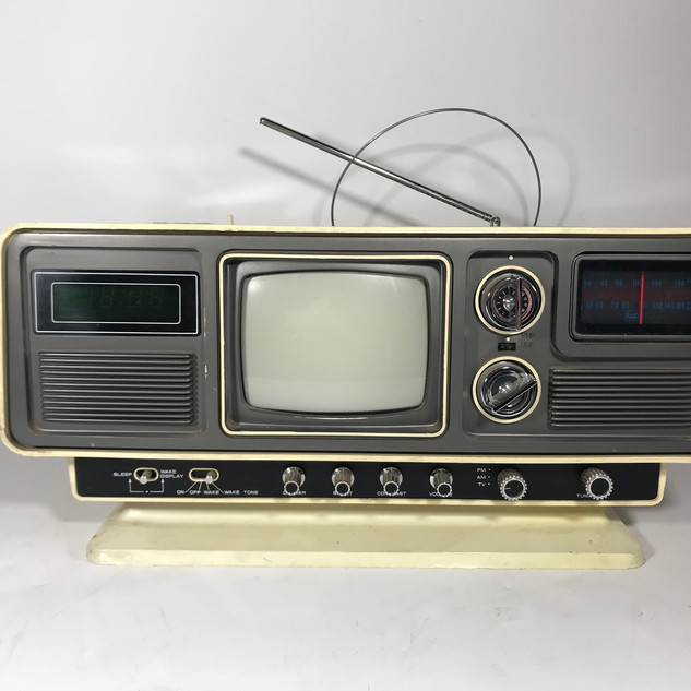AM/FM radio and small television console