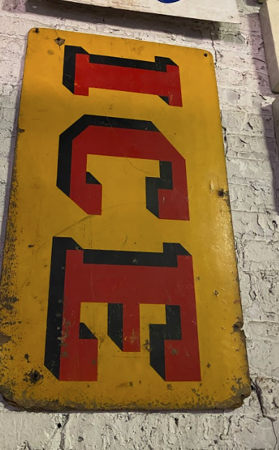 """Yellow sign with """"ICE"""" in red"""