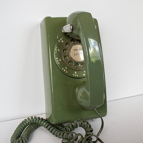 green rotary wall telephone