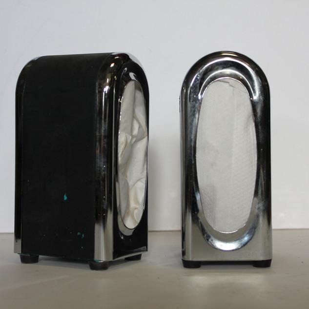 black and silver napkin dispenser