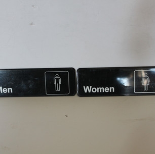 Modern men's and women's restroom signs