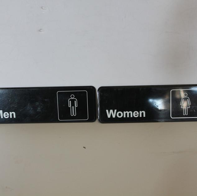 Modern men's and women's restroom signs