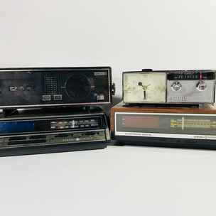 Amoco radio clock (top left) General radio clock (bottom left) General Electric radio clock (top right ) Gernal Electric wood grain radio clock (bottom right)