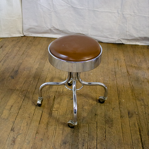 Silver Low Rolling Stool with Brown Seat Cushion