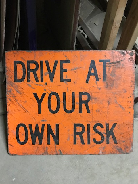 Drive at Your Own Risk Sign