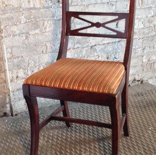3 in stock  Red toned wooden dining chair with padded seat cushion
