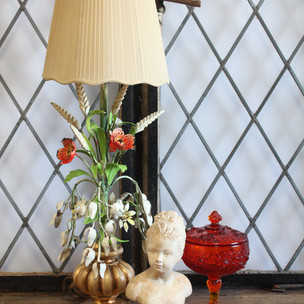 Floral lamp, bust statue
