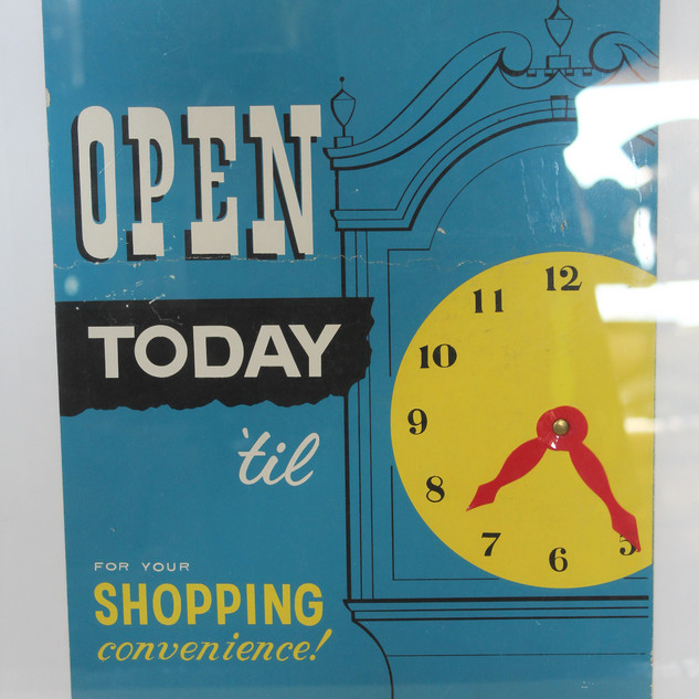 Open Today 'til clock sign