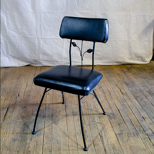 Black Chair with Leaf Detail