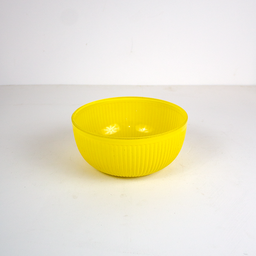 Yellow ribbed glass bowl