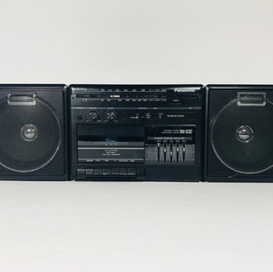 Black Panasonic boom box with cassette tape player and recorder