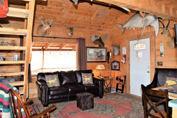 Big Horn Log Cabin living room area with sleeper sofa