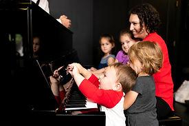 Jen family at piano.JPG