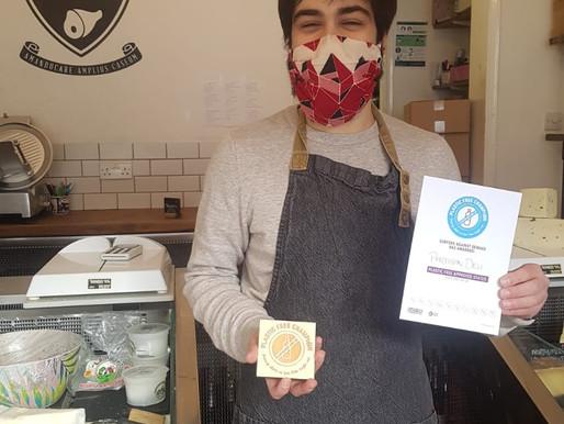 Partisan Deli receives Plastic Free Champion Award!
