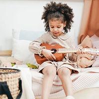 girl plays ukulele.jpg