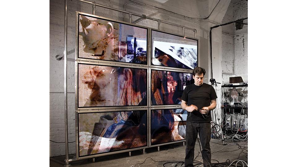Lincoln Schatz, Collision of Memory commission for One Arts Plaza, Dallas, TX, 2007, 12 plasma screens, 2 computers, 2 cameras, custom software, 9 x 9 each wall. Photo Courtesy